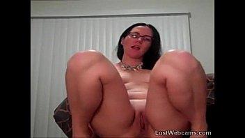 Brunette with glasses masturbates on cam